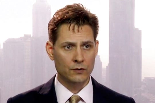 In this March 28, 2018, file image made from video, Michael Kovrig, an adviser with the International Crisis Group, a Brussels-based non-governmental organization, speaks during an interview in Hong Kong.