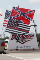 A truck with a Confederate flag drives by the entrance to Talladega on Sunday.