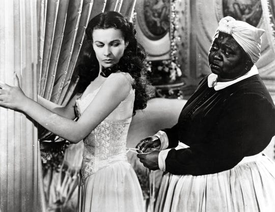 "Vivien Leigh and Hattie McDaniel in the film ""Gone With the Wind."""