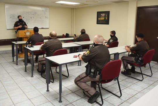 Ramsey, at the podium, does roll call with deputies on activities and patrol areas. Local police departments and sheriff's offices across Metro Detroit are looking at how they can update training, policies and disciplinary procedures in light of the protests against police brutality since George Floyd's death.