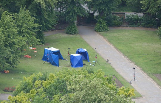 An aerial view showing police tents in Forbury Gardens at the scene of a multiple stabbing attack which took place on Saturday, in Reading, England, Sunday June 21, 2020.