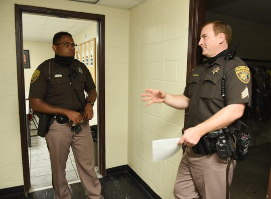From left, Deputy Sam James and Sgt. Ian Ramsey talk after the roll call meeting. Local police departments and sheriff's offices across Metro Detroit are looking at how they can update training, policies and disciplinary procedures in light of the protests against police brutality since George Floyd's death.