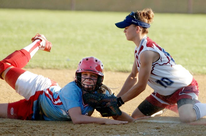 Union County's Whitney Brag (33) jumps safely back to first base as Henderson County's Tiffani Farley (10) tries to lay down the tag during the 2006 district championship game at North Field.