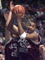 Henderson County's Ervin Miller pulls down a rebound during his team's 73-71 double overtime win over Muhlenberg North in the 1999 Sweet Sixteen quarterfinal matchup. Teammate Brent Gibson is at left.