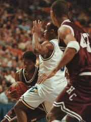 Henderson County's Tim Barnes (11) drives to the basket against Muhlenberg North's Jon Frazier (5) during the 1999 Sweet 16 at Rupp Arena.