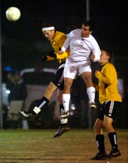 Henderson County's Jordan Gregory goes up for a header in the 2008 sectional show down for a berth in the state final four at Colonel Field.