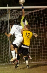 Henderson County's Sam Burke and goalie Ryan Crooke battle with Heath's Matt Kreutzer at the Heath goal in the 2008 sectional show down for a berth in the state final four at Colonel Field.