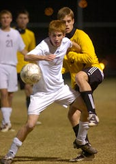 Henderson County's Colin Peters battles with Heath's Corey Drake in a sectional show down for a berth in the 2008 state final four at Colonel Field.