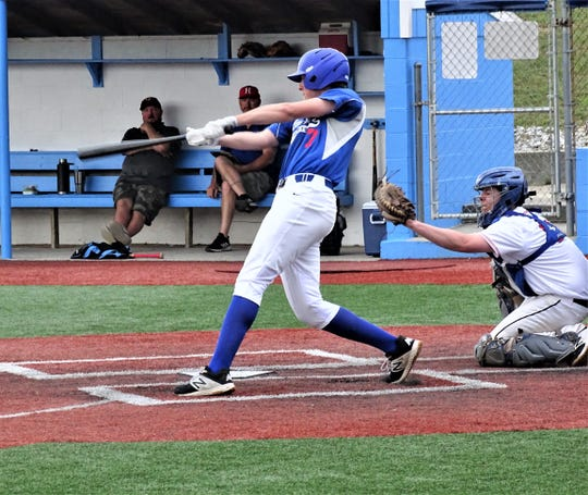 Lancaster Post 11's Nathan Hoffman rips a two-run triple against Guernsey County Thursday during the Beavers' Dame Wood Bat Tournament at Beavers Field.