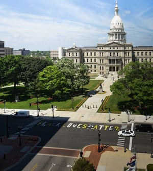 """""""Black Lives Matter"""" was painted on Capitol Avenue in front of the Michigan State Capitol Friday, June 19, 2020.  The project was spearheaded by Ferrin Mitchell, a Lansing native."""