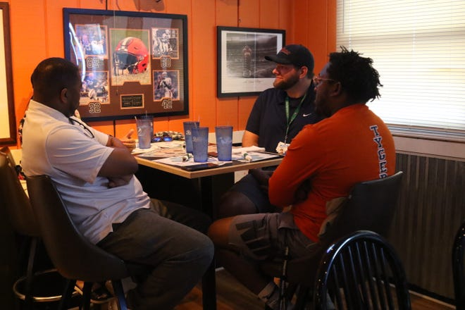 Mansfield News Journal sports reporter Jake Furr listens to Teana Sykes, Marquis Sykes and Jacob Owens as the four of them sat down for a great conversation about race.