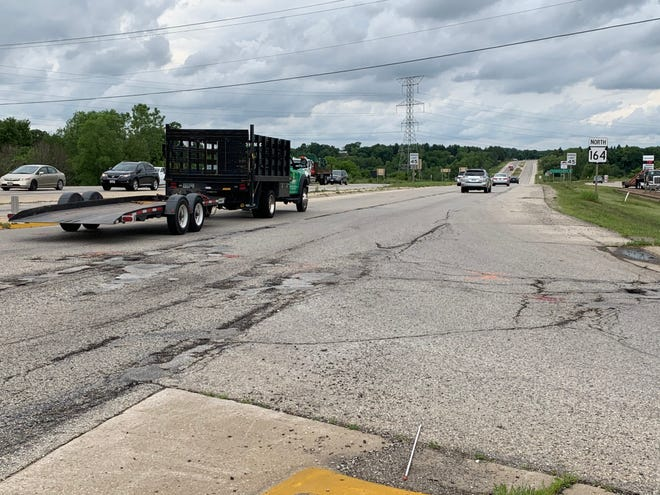 Highway 164 (shown here looking north from National Avenue in Big Bend) will be rehabilitated from National to Les Paul Parkway in the village of Waukesha beginning Monday, June 29. The 4.5-mile Wisconsin Department of Transportation project will involve the milling and repaving of the road surface, among other work, forcing traffic to travel in a single lane in each direction on one side of the median until fall.