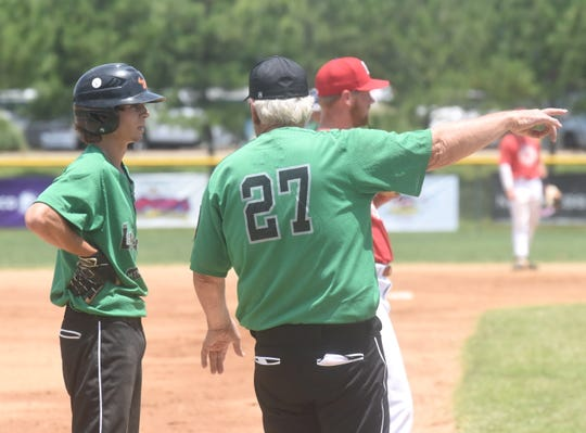 Lockeroom head coach Lester White instructs Gage Harris at third base during their team's 6-3 loss to Pontotoc, Miss., Sunday afternoon in the Twin Lakes Classic. Harris batted 8-for-12 in the tournament for a .667 average.