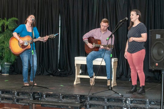 "Britt Johnson, left, and MC Jones, right, of Those Girls are accompanied by Colby Register in a recent performance of ""All In"" at The Sanctuary in Montgomery."