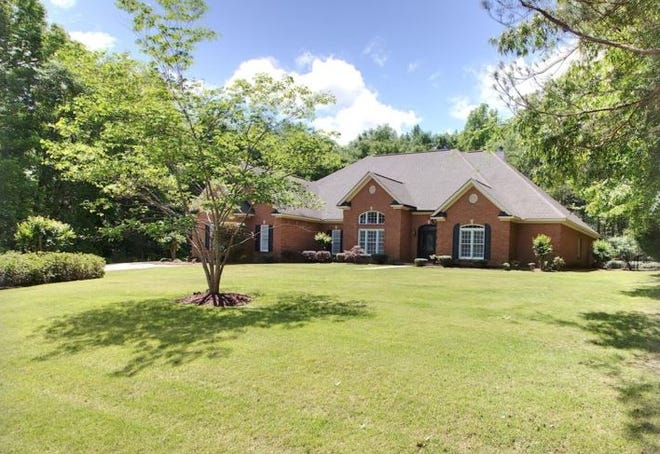 One Burton Manor estate home is for sale for $571,000 and includes four bedrooms and six bathrooms within 5,771 square feet of living space.