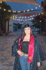 Brianna Campos smiles in her cap and gown. Campos will be starting her boot camp training in November. She wants to be a firefighter or engineering technician within the U.S. Navy.