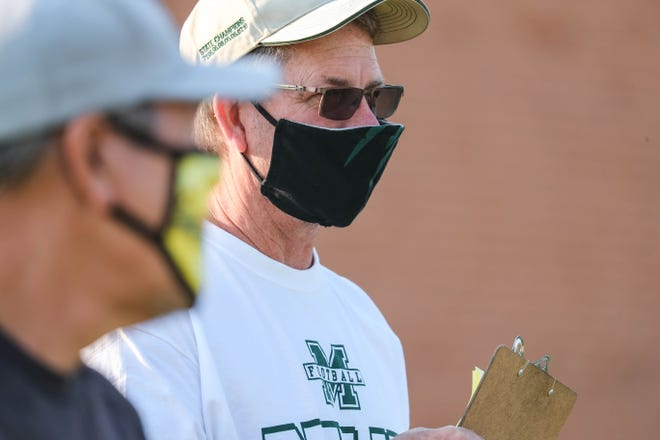 Mayfield head coach Michael Bradley wears a mask as the football team run drills in their first practice in Las Cruces on Monday, June 22, 2020.