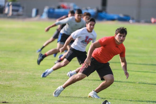 Las Cruces High School senior Armando Villescas (front) runs some drills during practice on Monday, June 22, 2020.