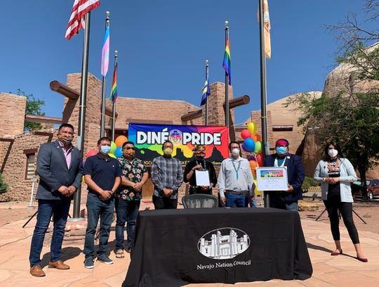 From left, board members for Diné Pride Alray Nelson, Brennen Yonnie, Curtis Berry, Rapheal Begay and Geronimo Louie stand with Delegate Carl Slater, Speaker Seth Damon and Delegate Charlaine Tso after the signing event to declare Diné Pride Week on the Navajo Nation on June 22 in Window Rock, Arizona.
