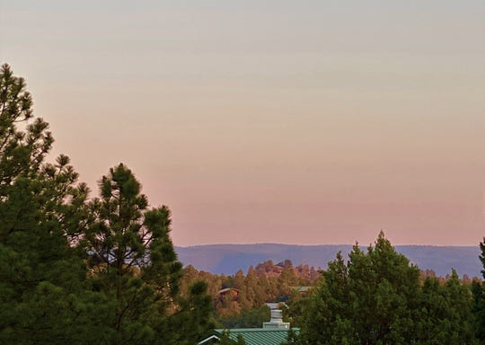A smokey haze covered Lincoln County over-looking Ruidoso on June 21 with a sunset like appearance that filled the air. Winds continued to move the smoke into the area.