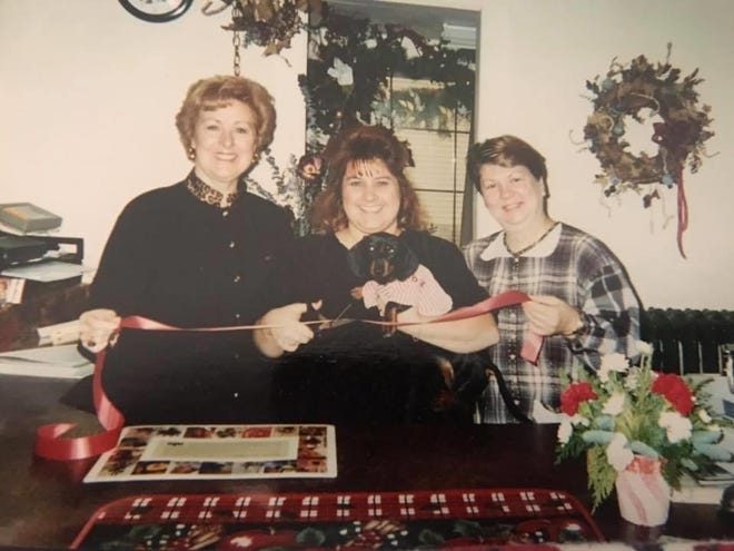 Lori Morrison with her mother Marcia Sayles and Pat Ribar at the ribbon cutting of the florist back in 2000.