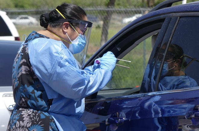 A health worker administers a coronavirus test in San Bernardino County.