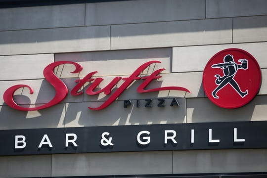 A sign for Stuft Pizza Bar & Grill sits on the exterior of the building on Monday, June 22, 2020 in Palm Desert, Calif.