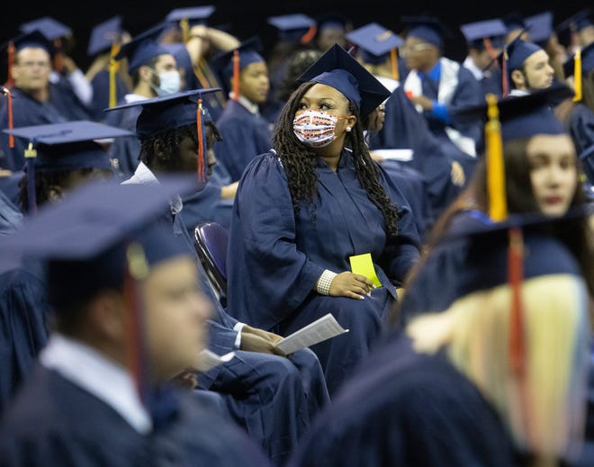 Members of the Escambia High School class of 2020 gather at the Pensacola Bay Center on Monday, June 22, 2020, to take part in graduation. This year's commencement was delay nearly a month because of the COVID-19 pandemic.