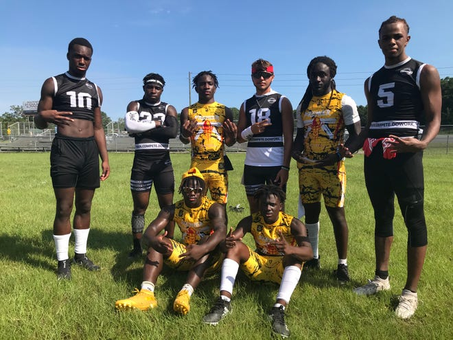 Standouts players from the Final Battle between Premier Elite 7v7 (yellow uniforms) and Team DoWork. (Back row, L to R) Raymond Cottrell, Trey Carlisle, Hershell Jefferson, Dawson Butalla, San'Tonio Coleman, Erick Smith, (front row L to R) Waymond Jordan and Aiden Freeman.