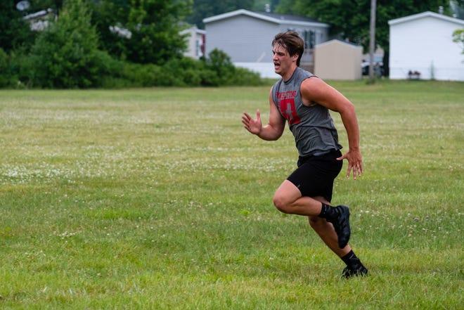 St. Clair senior linebacker Aiden Gaedcke runs drills during practice Monday, June 22, 2020, at St. Clair High School.