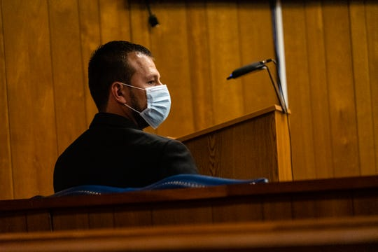 Ricardo Galan II is seated at the defendant's table during an examination hearing Monday.