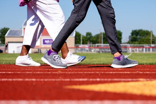Sadie Russell, left, and Janie Williams walk laps on the track near Port Huron High School Friday, June 19, 2020.