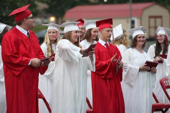 Graduates from Cumberland Valley Christian School in Chambersburg, Pa., graduate Friday at the Open Door Church on the school's campus.