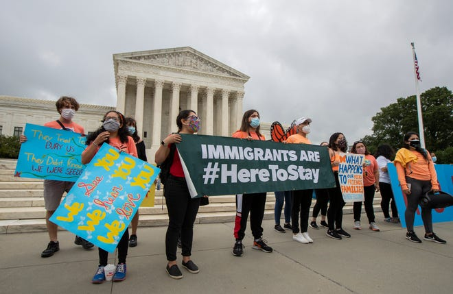 In this June 18, 2020, photo, Deferred Action for Childhood Arrivals (DACA) students celebrate in front of the Supreme Court after the Supreme Court rejected President Donald Trump's effort to end legal protections for young immigrants in Washington. Less than five months from Election Day, President Donald Trump is positioning himself as the spokesman for voters resisting a new wave of cultural change, ready to ride any backlash from the protests calling for racial equality and police reform and this week's Supreme Court rulings extending protections to gay workers and young immigrants. (AP Photo/Manuel Balce Ceneta)