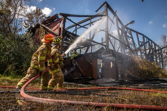 Firefighters work at the scene of a second-alarm barn fire on Ridge Avenue near Old Ridge Avenue, Sunday, June 21, 2020, in Penn Township. No one was injured in the fire, which occurred in a vacant barn back a long driveway, said Hanover Area Fire & Rescue Chief Tony Clousher.
