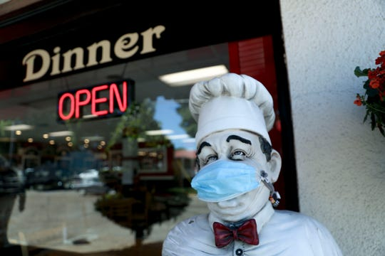 The welcoming statue is seen with a mask on at Gerry Frank's Konditorei in Salem, Oregon on Monday, June 22, 2020.