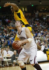 Bronte High School's Heath Richey waits for an opening to shoot against Cayuga on March 13, 2010, in the state final.