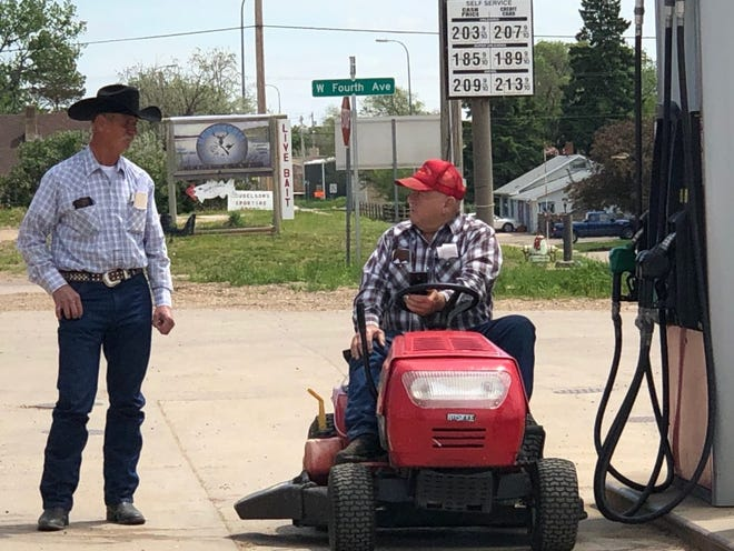 Transportation takes many forms in small towns in South Dakota, including on a Sunday in Faith, a remote agricultural town in eastern Meade County, where two men paused to chat at the local gas station.