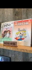 Cartoon sketch covers by Lamont Hunt at the new Tally Ho Art Gallery in Brandon.