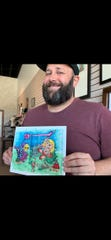 Co-owner Lamont Hunt holds some of his artwork at the new Tally Ho Art Gallery in Brandon.