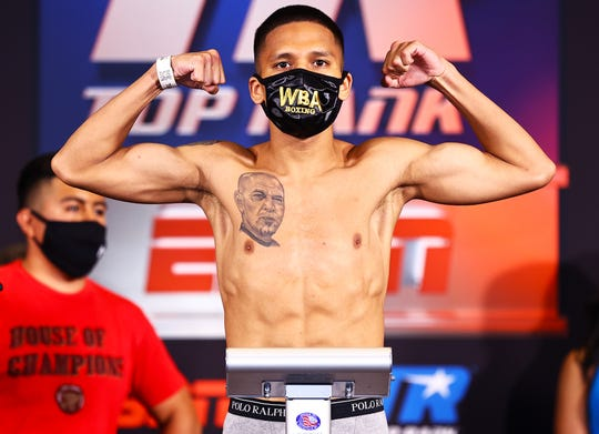 Joshua Franco flexes at Monday's weigh-in at Las Vegas.