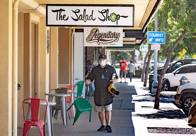 John Lawson readies for customers at The Salad Shop in Downtown Visalia on Monday, June 22, 2020.