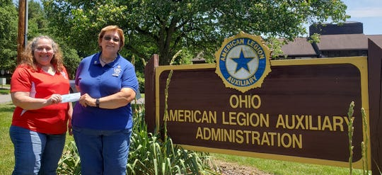 Vicky Buck (left), Ohio American Legion Auxiliary Buckeye Girls State Coordinator receives a $300 donation from Liz Herrell, Ohio Business and Professional Women (BPW) Vice President and Zanesville BPW member.