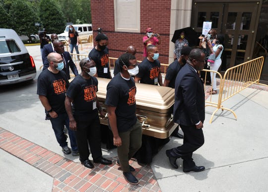 Pallbearers bring the remains of Rayshard Brooks into the Ebenezer Baptist Church for his viewing on June 22, 2020 in Atlanta.