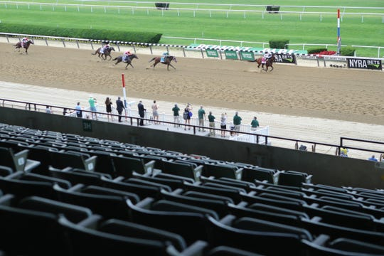 Tiz the Law (8) with Manuel Franco up, wins the 152nd running of the Belmont Stakes in front of a mostly empty grandstand at Belmont Park on June 20.