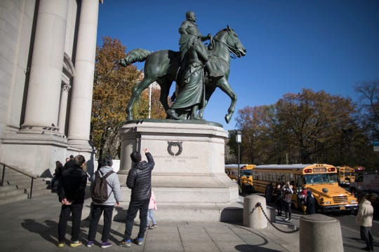 The statue of Theodore Roosevelt flanked by a Native American man and African American man outside the American Museum of Natural History in New York will be coming down.