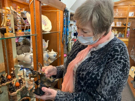 In this June 2, 2020, file photo, Donna Knight, of Wasilla, Alaska, shops at a tourist gift shop in Talkeetna, Alaska.