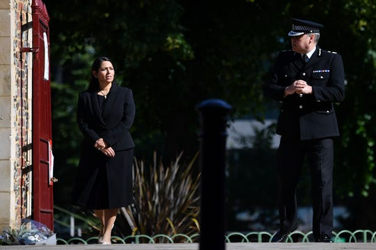 Britain's Home Secretary Priti Patel, left, and Thames Valley Police's Chief Constable John Campbell visit the scene of a terror attack in Forbury Gardens park in Reading, west of London, on June 21, 2020.