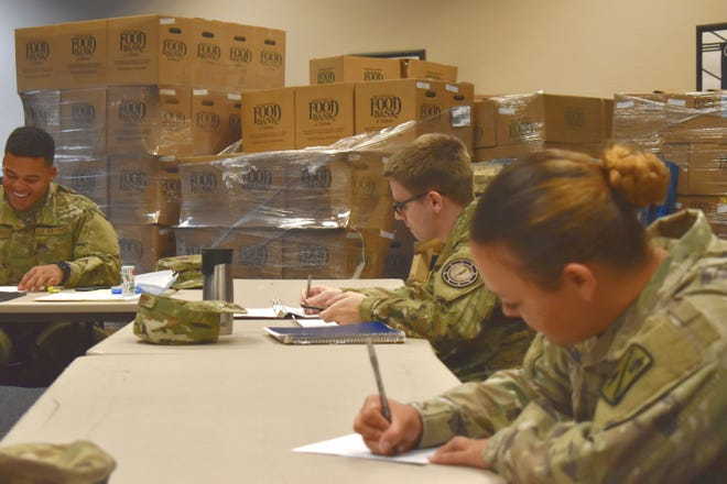 Members of the Oklahoma National Guard serve as contact tracers for state health workers Tuesday. A 12-member team serving in southern Oklahoma is currently helping health officials mitigate the spread of COVID-19.