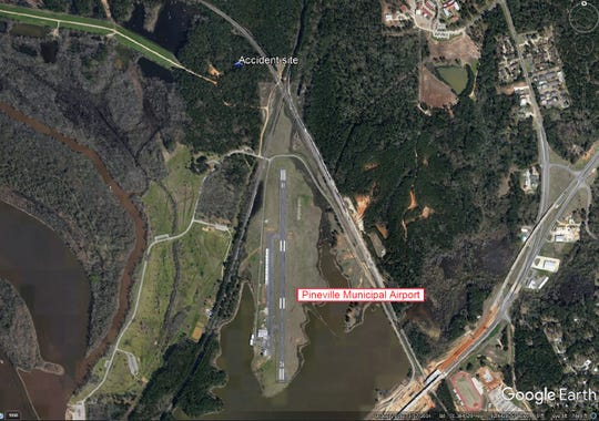 A photo taken from the National Transportation Safety Board's preliminary report shows where a small plane crashed near the Pineville Municipal Airport after takeoff on May 31. The crash killed twin brothers and seriously injured the son of one of the men.